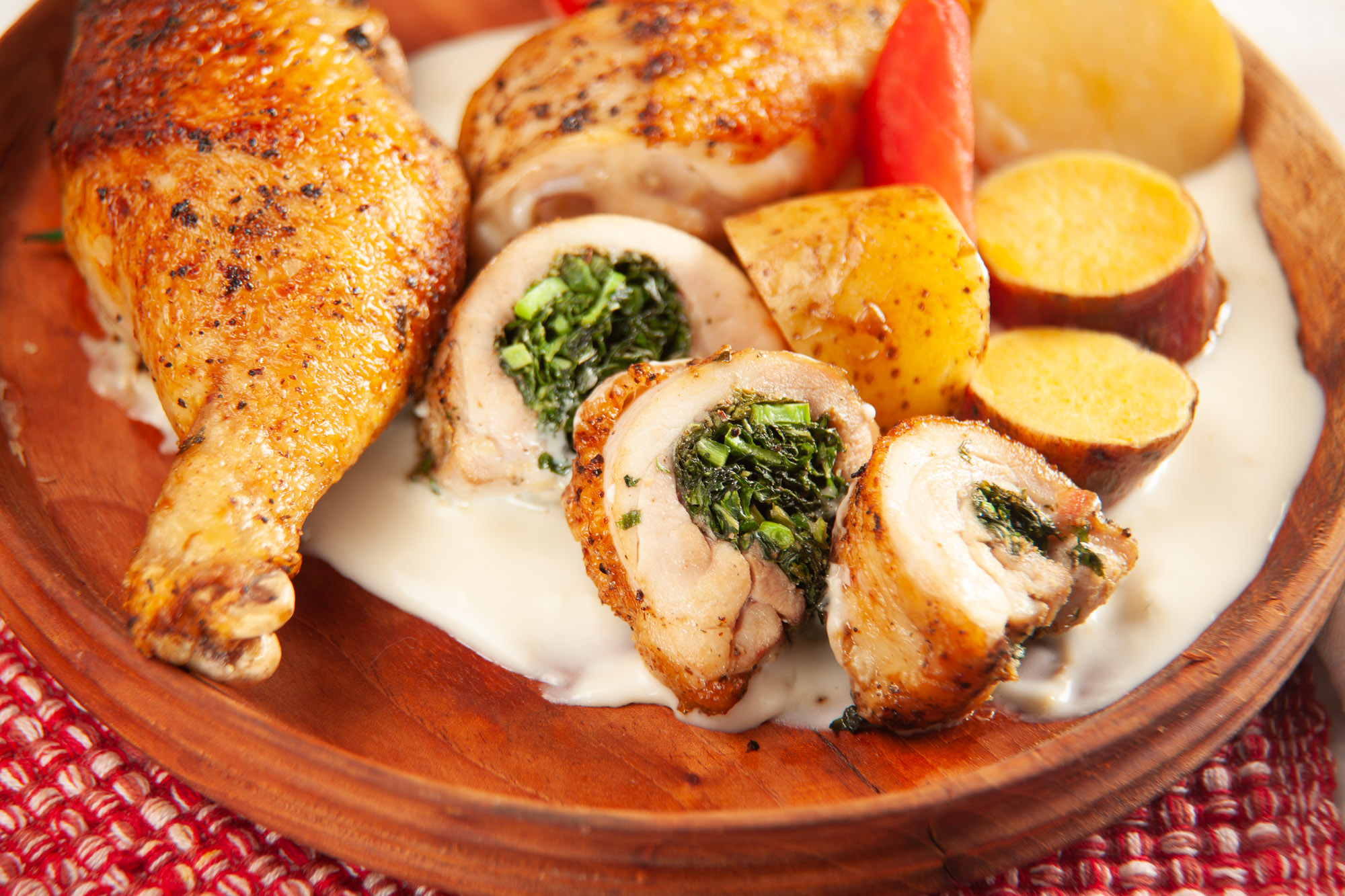 Callaloo Stuffed Chicken Leg Quarters  with Alfredo Sauce